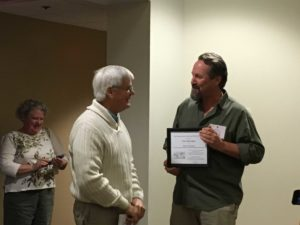 SEERS President Erik Smith (right) presents longtime member and former board member Clay Montague (center) with Honorary Membership.